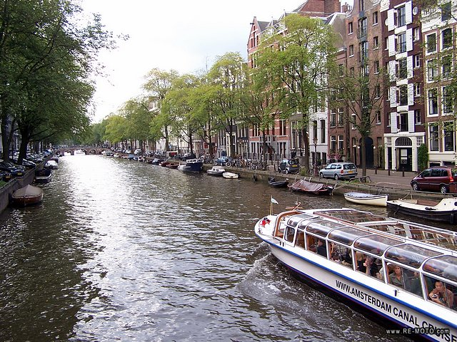 The old quarter of Amsterdam is surrounded by a magical belt of semi-circular canals.