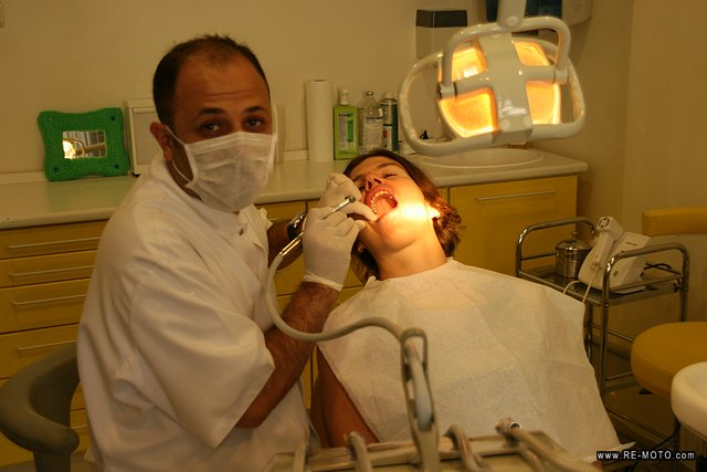 Panur, dentist and motorcyclist, alleviating Elke's pain.
